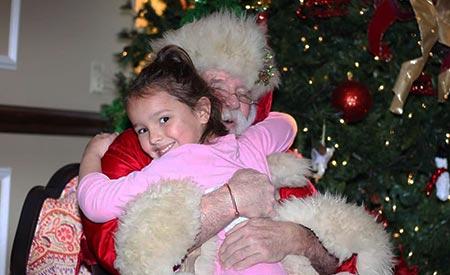 Kiddi Kollege Girl Hugging Santa
